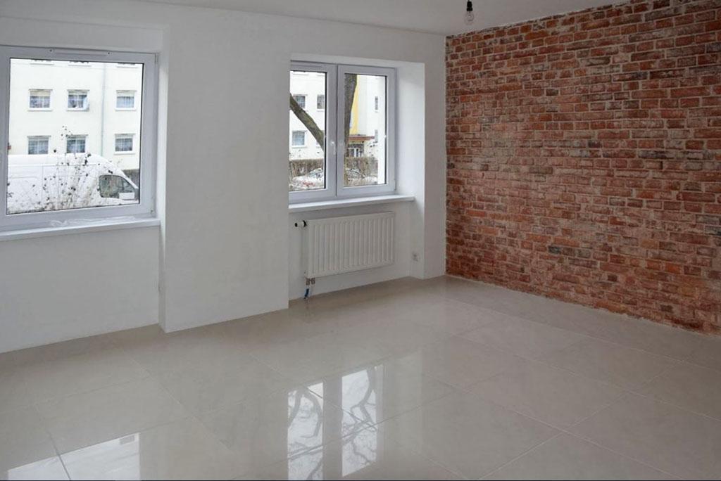 zdjęcie przedstawia duży pokój w mieszkaniu do sprzedaży, w dzielnicy Fabryczna we Wrocławiu