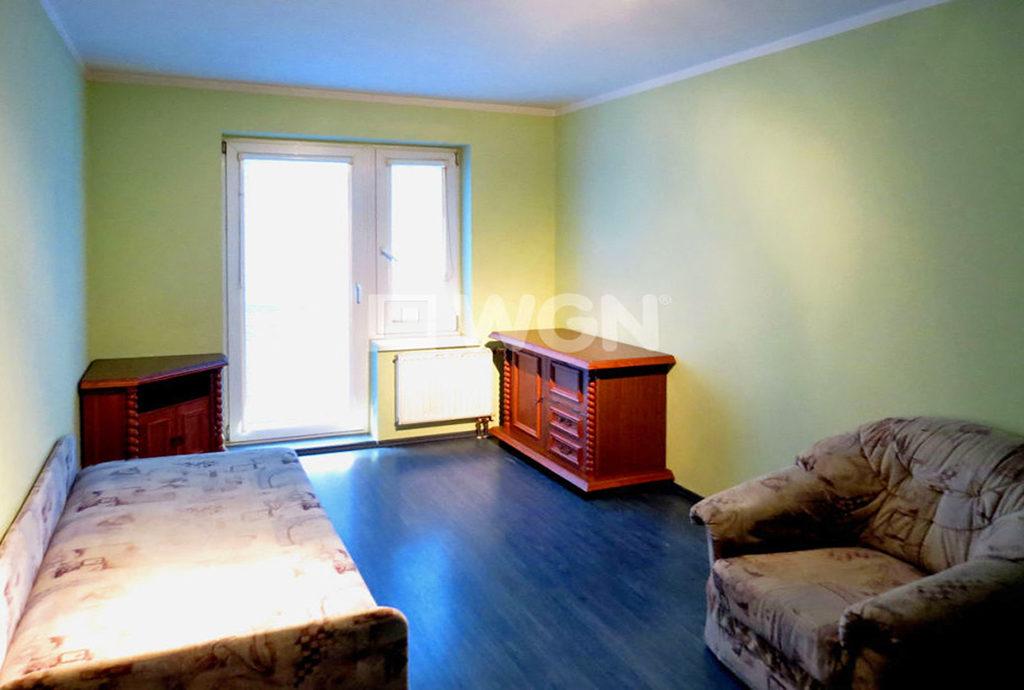na zdjęciu sypialnia w mieszkaniu na sprzedaż we Wrocławiu
