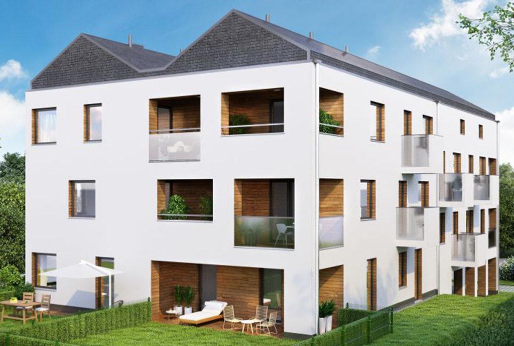 widok z lotu ptaka na apartamentowiec, gdzie mieści się oferowane na sprzedaż mieszkanie we Wrocławiu (okolice)