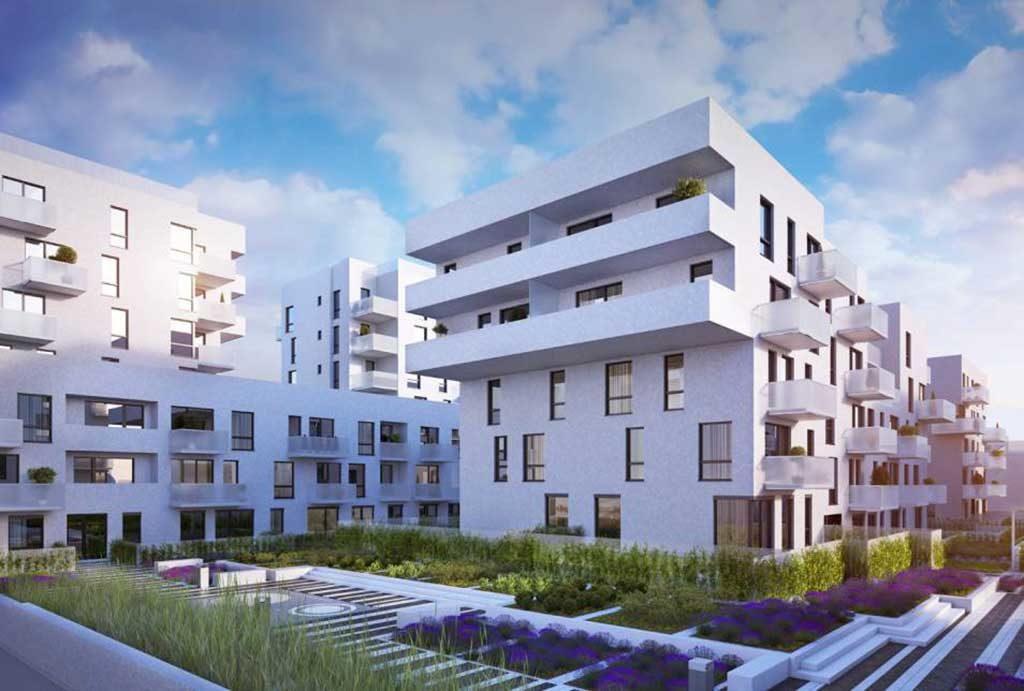 widok od strony osiedla na nowoczesny apartamentowiec we Wrocławiu, gdzie mieści się oferowane na sprzedaż mieszkanie