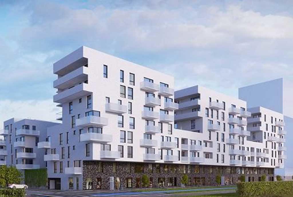 rzut od strony ulicy pokazujący nowoczesny apartamentowiec we Wrocławiu, w którym znajduje się oferowane do sprzedaży mieszkanie
