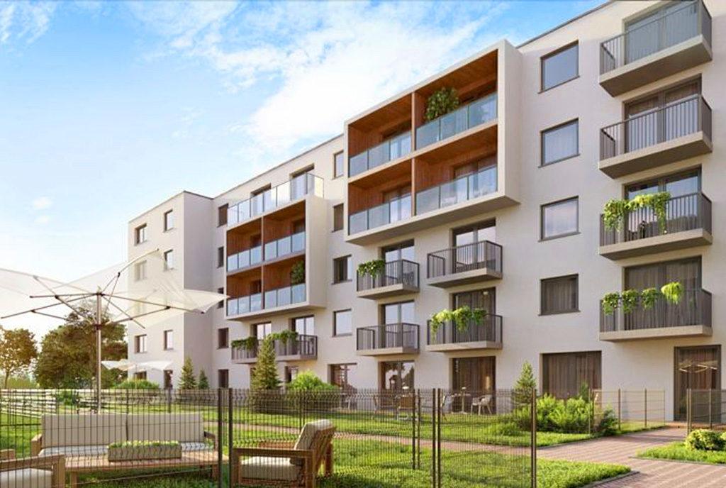 widok od strony osiedla na budynek, gdzie usytuowane jest mieszkanie na sprzedaż Wrocław Psie Pole
