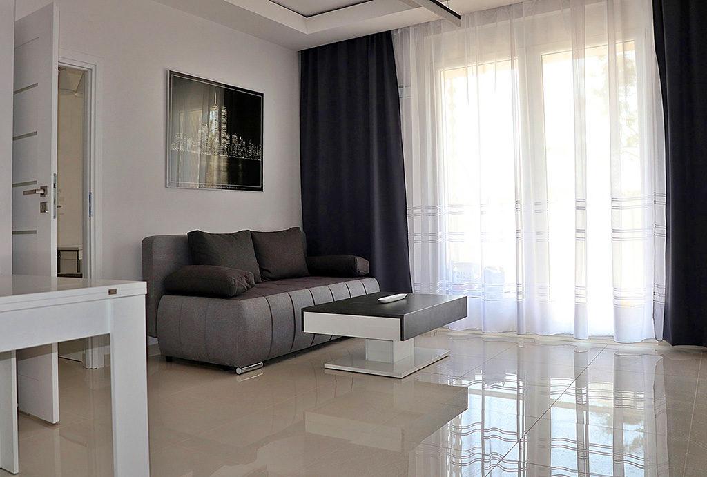 wytworny, luksusowy salon w ekskluzywnym apartamencie do wynajęcia Wrocław Stare Miasto