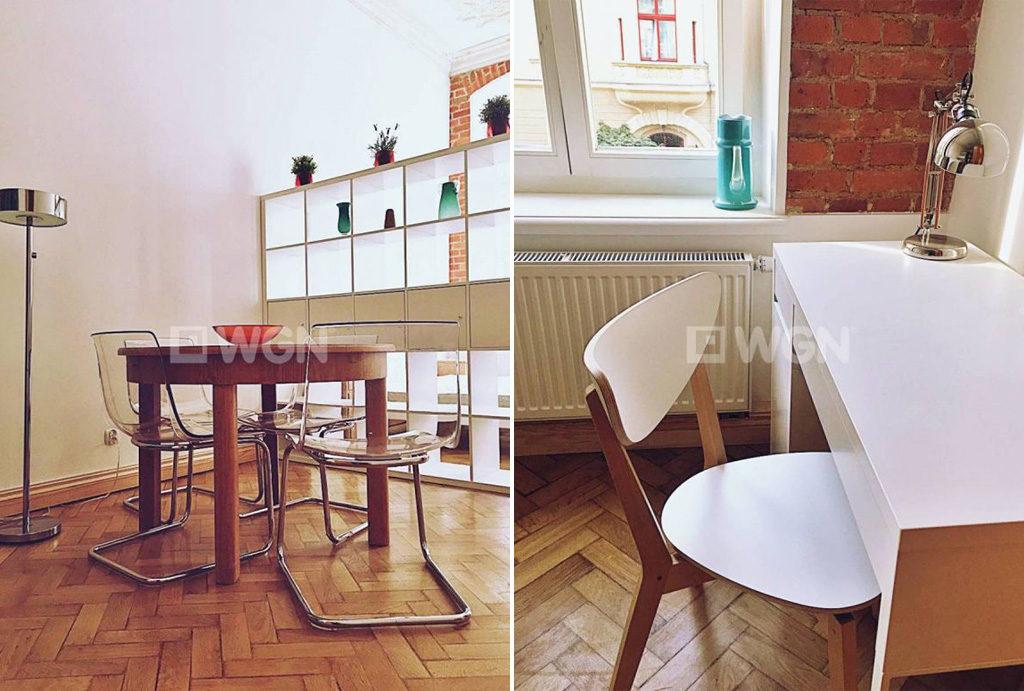 na zdjęciach kuchnia i salon z kominkiem w mieszkaniu do wynajmu Wrocław Śródmieście