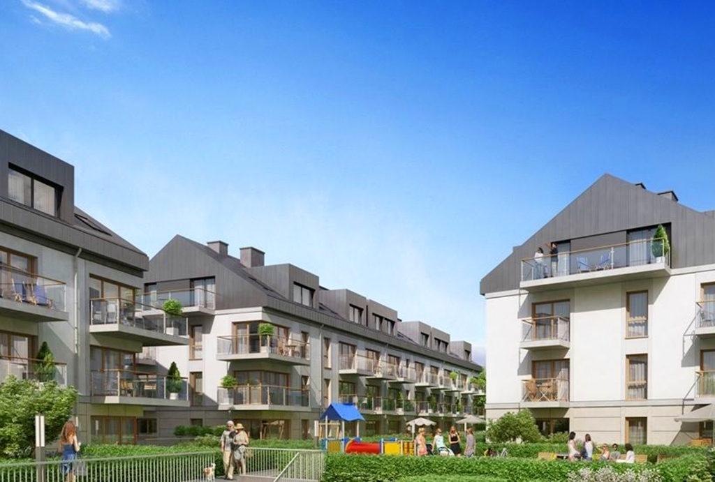 widok od strony placu zabaw na budynek, gdzie znajduje się mieszkanie na sprzedaż Wrocław Krzyki
