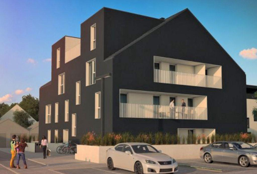 zdjęcie wykonane podczas zachodu słońca prezentujące apartamentowiec, w którym mieści się oferowane do sprzedaży mieszkanie Wrocław Siechnice