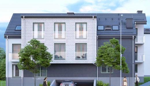 na pierwszym planie wjazd do garażu podziemnego w apartamentowcu, gdzie mieści się oferowane do sprzedaży mieszkanie Wrocław Fabryczna