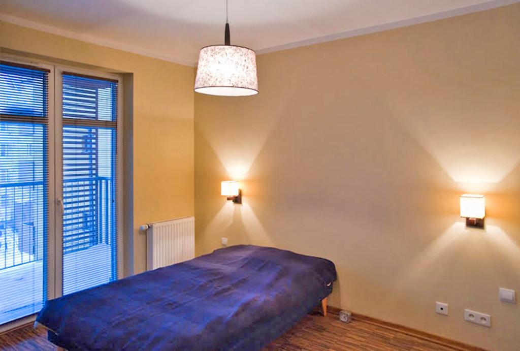 elegancka sypialnia w mieszkaniu na wynajem Wrocław